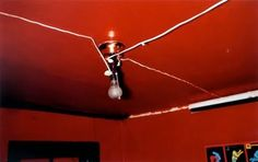 William Eggleston-  Check out the leading lines for this photo and all the deep red coloring. Eggleston can always bring beauty out in the most unlikely objects like a boring old light fixture and electrical wiring.  This photo is simply interesting.