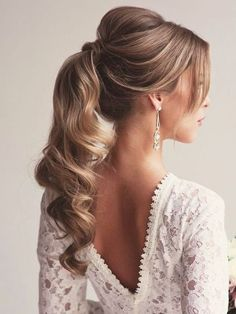 Take a look at the 15 best ponytail wedding hairstyle photos in the photos below and get ideas for your wedding!!! Rustic Wedding Hairstyle Low Ponytail | Brides.com Image source