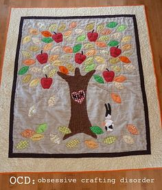 Tree quilt ....idea for art for kindergarten class auction item.   Maybe have Jesus written on the tree trunk with parent & teacher names on apples and kids names written on the leaves?   Scripture ???