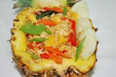 Pineapple basil fried rice with red bell pepper, carrots, sugar snap peas, basil, cucumber