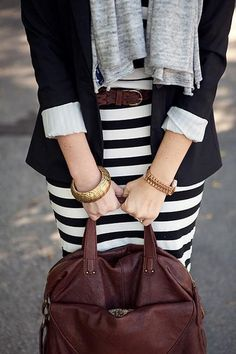 My black blazer, a white top and my striped skirt with my red beaded necklace, earrings and red shoes.