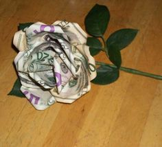 How to turn paper bill inot a money flower. I remember a HS student recieving 16 money roses on her 16th birthday. I always wanted to learn hwo to make these. No money was injured in the making of a flower. Monday was only folded and pinched.