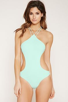 16a176dd3d6 A stretch knit monokini with twisted straps that crisscross in back and a  back slide-