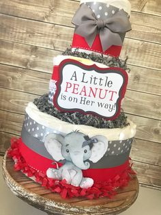 Little Peanut Diaper Cake in Red and Gray, Elephant Baby Shower Centerpiece, Elephant Diaper Cake for Girls by AllDiaperCakes on Etsy https://www.etsy.com/listing/585705326/little-peanut-diaper-cake-in-red-and