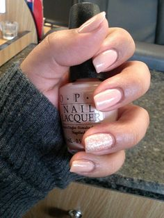 Opi nude pink with glitter ring finger