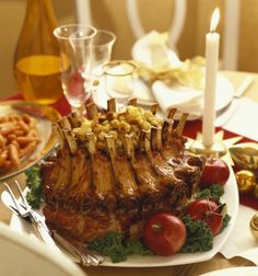 Crown roast of pork stuffed with cornbread, sausage, apple and cranberry stuffing with pan gravy