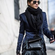 Navy and black make for an effortlessly chic combination, take your fashion week cue from this stylish show goer and pair with a statement fringed bag – this season's most desirable detail. #OutfitEnvy Photography by #theurbanspotter