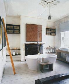 tub, glass shower, white plank floors, fireplace, art, chendelier: the perfect room