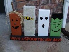 2x4 craft: painted to look like jack o'lantern, mummy, ghost, and Frankenstein monster