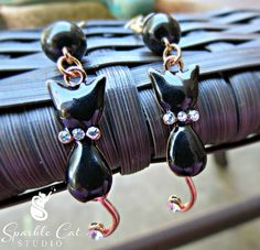 Black Cat Halloween Dangle Pierced Earrings by SparkleCatStudio.  Find us on Facebook here: https://www.facebook.com/SparkleCatStudio  We donate 25% of our proceeds to animal rescues.
