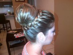 messy braided up do by Betzy Acosta