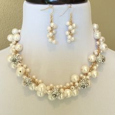 Cluster Of Pearls Necklace Set Stunning pearl with bling necklace set.  Simply fun n classy.  It's approx. 22 inches long.  You can adjust the length to make it long or short.  Love the cluster of pearls to wear for any occasion. Jewelry Necklaces