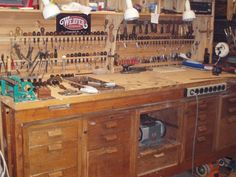 """Magnet strip, 5/8"""" holes for screwdriver organization, power strip mounted; lots of cool workshop O ideas!"""