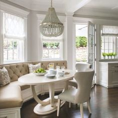 Another breakfast nook window seat with Roman shaded windows. (No to the chandelier-table-chairs! Kitchen Booths, Kitchen Seating, Kitchen Benches, Kitchen Banquette Ideas, Kitchen Layout, Built In Dining Room Seating, Banquet Seating, Kitchen Breakfast Nooks, Breakfast Nook Bench