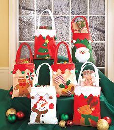 Set of 6 Embellished Holiday Treat Bags is an affordable way to dress up wrapped treats or small gifts for the season. Each bag has detailed embellishments Christmas Gift Bags, Christmas Sewing, Christmas Embroidery, Felt Christmas, Book Crafts, Felt Crafts, Holiday Crafts, Diy And Crafts, Xmas Ornaments