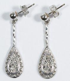 Lot 141: 14k White Gold and Diamond Pierced Earrings; Each dangle earring having six round cut diamond chips; backers marked