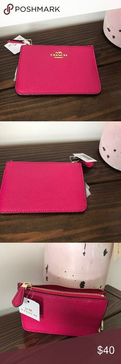 Coach KEY pouch in polished pebble leather (pink) A darling little pouch designed to hold keys and other small essentials makes a luxurious handful in finely textured pebble leather that is wonderful to the touch. The design is elegantly lined and finished with polished signature hardware. Coach Bags