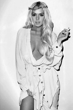 Lindsay Lohan by Terry Richardson. Edgy style yet there is something angelic about this look. Lohan is known for sometimes doing weird things, perhaps Richardson is trying to capture that here.
