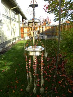 Wind chime art with assorted whimsical by WhisperingMetalworks