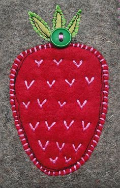 Applique strawberry with hand and machine embroidery. Yum!