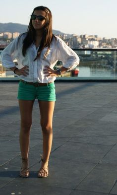 blouse and green shorts