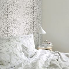 Marimekko Lumimarja Silver/White Wallpaper We are sorry but this item is sold out and no longer available. The shimmering silver of the Lumimarja wallpaper gives it the freshness and wonder of fresh fallen snow. Embossed Wallpaper, White Wallpaper, Wall Wallpaper, Wallpaper Ideas, Bedroom Wallpaper, Wallpaper Online, Wallpaper Roll, Marimekko Wallpaper, Marimekko Bedding