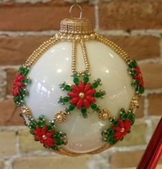 Join us for a fun afternoon with guest instructor Kate Singstock and whip up a beautiful Snowflower ornament designed by Bead & Button magazine editor Julia GeChristmas Ornament Silver and Gold Cover: Beading TutorialArts And Crafts Projects Key: 898 Beaded Christmas Decorations, Christmas Ornaments To Make, Diy Christmas Gifts, Handmade Christmas, Christmas Crafts, Felt Christmas, Modern Christmas, Beaded Ornament Covers, Beaded Ornaments