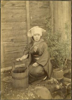 Woman with a water bucket, Japan.