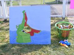 Neverland, Peter Pan, Tinkerbell, Tick Tock Croc Game. I used plywood, drew tick tock croc, painted him, and my father-in-law cut out the hole with his tools. The kids threw beanbags. Their prize was a Pirate Spyglass I made from Papertowel roll, covered in construction paper and the trim in gold duct tape.
