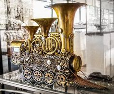 Steampunk Train built from old instruments. Cool.
