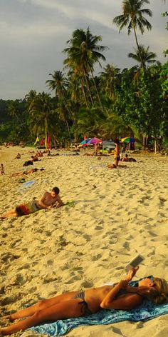 relaxing and reading on the beach in front of Bhumiyama Beach Resort Koh Chang, Ta Nam Beach (Lonely Beach).