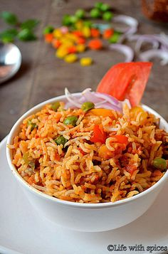 Mexican rice is a simple but flavorful variety rice which is cooked with beans and veggies with loads of canned tomatoes. Made this rice to suit our taste buds Quick Rice Recipes, One Pot Rice Meals, Stir Fry Rice, Mexican Style, Biryani, Fried Rice, Spices, Veggies, Cooking