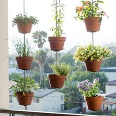One of our favorite and most popular DIYs of all time is our vertical clay pot garden. Using rods, nuts, washers, and flanges, you can create a flowery privacy screen in a single afternoon. It's great for patios and balconies! Find the full DIY in the April 2016 issue of BHG or on thehorticult.com. —Chantal & Ryan, @thehorticult #BHGTakeover #thehorticult #DIY #balconygardening