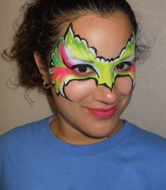 colourfull bird mask face painting...  Would look great in rainbow, peacock or blue tones.