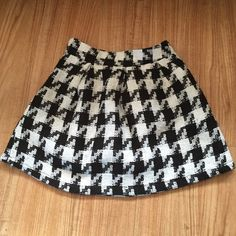 Houndstooth skater skirt Says its a large but fits like a small. I bought it off another posher and it doesn't fit me. Great condition! Good fabric Skirts