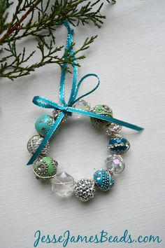Pretty little DIY Beaded Wreath, so lovely (and simple) for the holidays! I spy a quick and easy ornament, present topper, gift for a friend Unique Christmas Ornaments, Felt Christmas Decorations, Beaded Ornaments, How To Make Ornaments, Handmade Christmas, Diy Ornaments, Beaded Garland, Angel Ornaments, Rustic Christmas