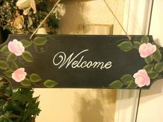 Hand painted roses on a sign by Cindy Lawhon
