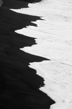 black sand and sea foam