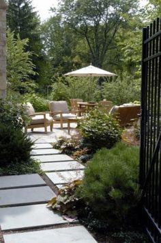 concrete steps leading to brick and concrete bordered patio