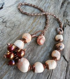 This necklace was created for a design challenge at Art Jewelry Elements using a sweet little ceramic shank button in an ammonite motif by Lesley