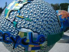 """More than 500 lbs of metal scrap embrace this Cool Globe, sending a message about reusing & recycling to reduce waste. Use reusable shopping bags. A recycled tin can saves enough energy to power a television for three hours. Use public transportation. Carpool. """"One of the best tools to fight global warming is eco-friendly creative thinking. Come up with your own innovative solutions to show one man's trash is the world's treasure."""" Don't Waste - Instead Create! by artist Mitch Levin"""