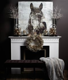 This horse print + Tall vases with branches and ornaments. Great mantle for you!
