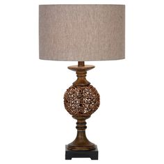 Illuminate your living room or den with this artful table lamp, showcasing a rattan orb base and classic drum shade.  Product: T...