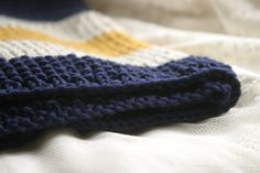 Navy Mustard and Cream hand knit baby blanket by knitternicole