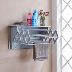 The Danya B. Accordion Drying Rack is perfect for saving space in your laundry room or bedroom. When it is needed it can easily extend to provide hanging racks and also has hooks along the bottom hold scarves, socks, and more. Shelves, Wall Mounted Drying Rack, Room Organization, Wall Shelves, Danya B, Home Decor, Light Grey Walls, Laundry Room Storage Shelves, Room Storage Diy