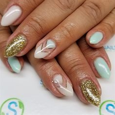 Nude, teal, and gold glitter nail art