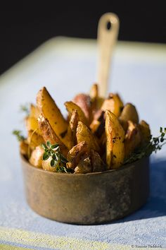 potato wedges + herbs in small copper pan