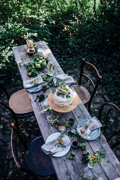 Great idea for outdoor seating at a wedding! Beautiful outdoor dining setting with wooden table and rustic vintage wooden chairs