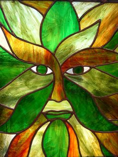 Green Man in stained glass.
