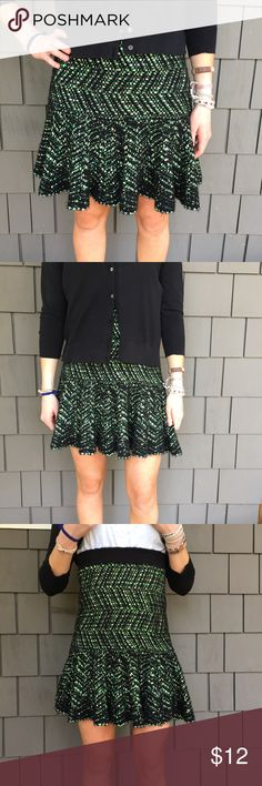 ANTHROPOLOGIE  skirt size S Anthropologie. Moth Cool black and neon green sweater skirt by Moth. Super comfortable. You can pull it way up to make a shorter skirt, or you can wear it right at the waist to have it hit right above the knees. It's super stretchy so fits just about anyone. It's cute with black boots and a black turtleneck sweater. The green material woven through it is kind of shiny with flecks of different color greens, teal, gold and cream. Skirts